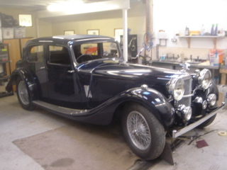 Alvis 1936 Restoration - Mudguards and running board strips, now firmly fixed. Bonnet and door catches and front lights fitted